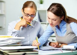 two people reviewing paperwork