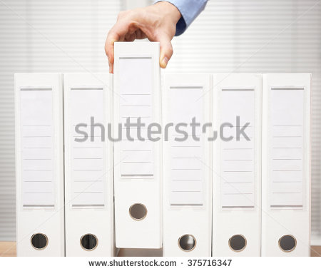 stock-photo-bookkeeper-took-a-binder-from-the-archive-bookkeeping-and-accounting-concept-375716347