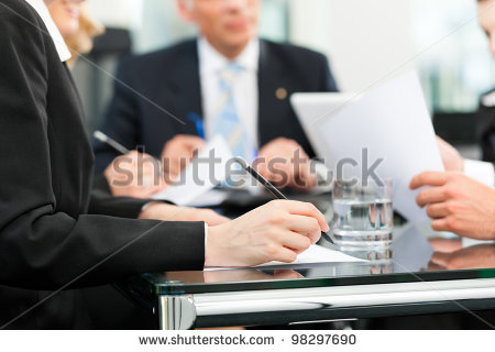stock-photo-business-meeting-in-an-office-lawyers-or-attorneys-discussing-a-document-or-contract-agreement-98297690