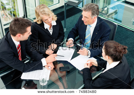 stock-photo-business-meeting-in-an-office-the-businesspeople-are-discussing-a-document-74983480