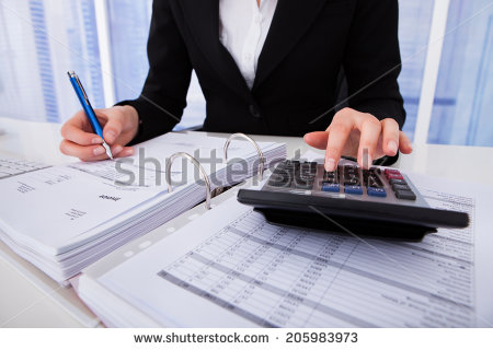stock-photo-midsection-of-businesswoman-calculating-tax-at-office-desk-205983973