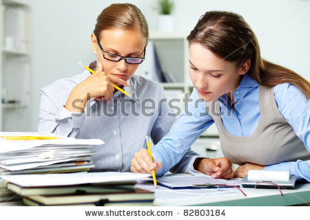 stock-photo-portrait-of-two-businesswomen-working-with-papers-in-office-82803184