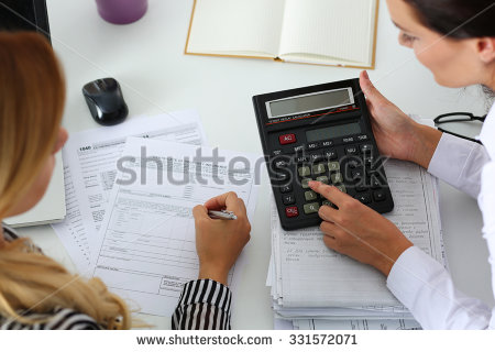 stock-photo-two-female-accountants-counting-on-calculator-income-for-tax-form-completion-hands-closeup-331572071