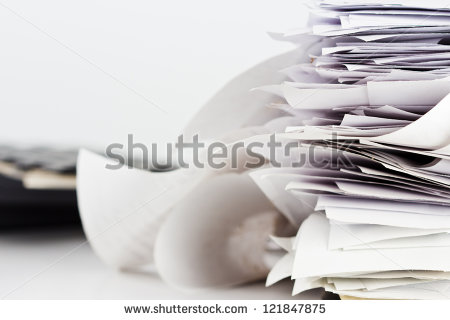 stock-photo-pile-of-receipts-on-the-desk-121847875