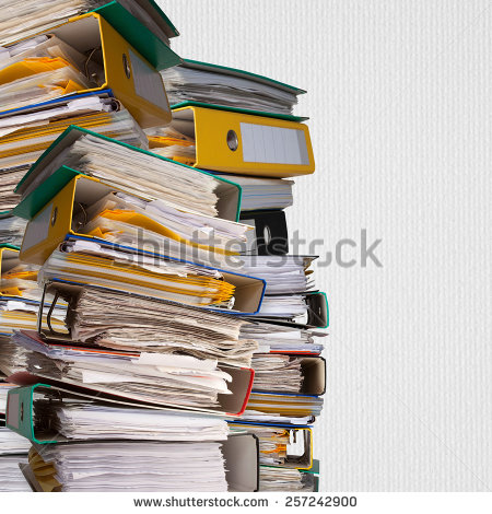 stock-photo--piles-of-file-binder-with-documents-on-white-paper-background-257242900